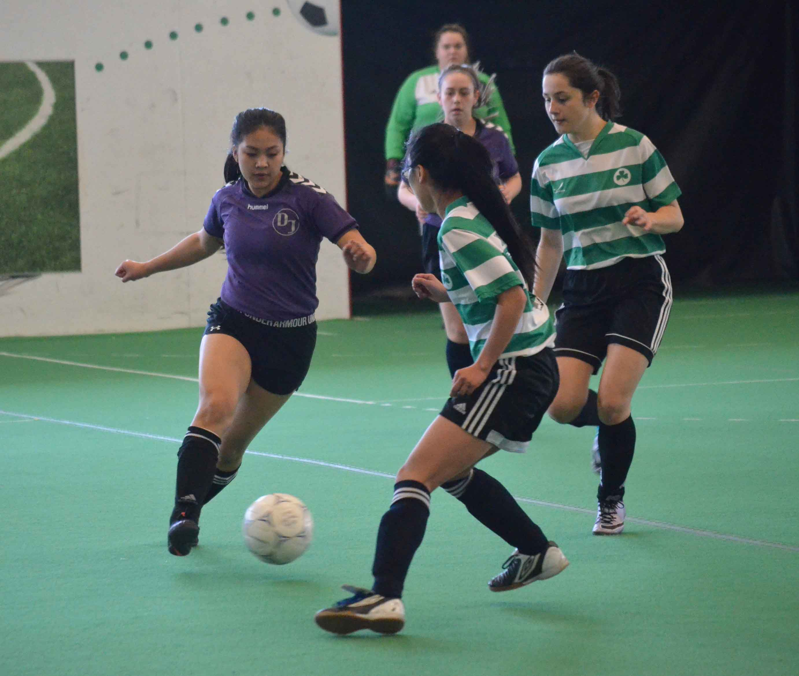 Riella Bordey of the U-19 girls' team from Diamond Jenness Secondary School competes against players from St. Patrick's High School during the recent Senior Super Soccer tournament in Yellowknife. James McCarthy/NNSL photo