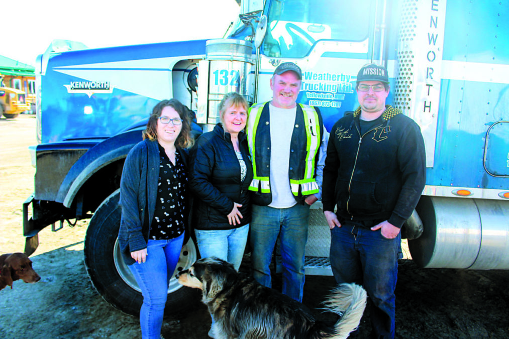 Blair Weatherby, who started Weatherby Trucking LTD, with his wife and kids, all of whom work in family businesses. Blair started his company with one truck and has now expanded his fleet into dozens of trucks and heavy construction vehicles. From the left, Aven Tremblett, Kelly Weatherby, Blair Weatherby and Dustin Philippon. Brett McGarry / NNSL photo