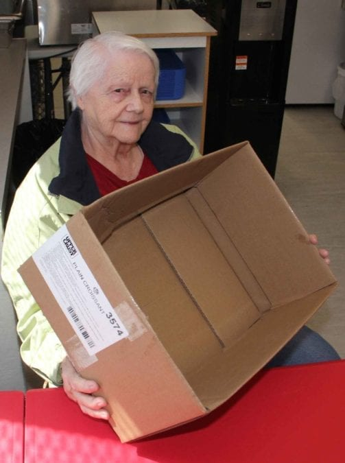 Betty Robinson, an honourary board member of the Hay River Soup Kitchen, holds an empty box that would normally become a hamper filled with food for some needy individual or family. Because of higher demand for food and rising prices, the Soup Kitchen has decided to just continue offering lunches three times a week for the foreseeable future. Paul Bickford/NNSL photo