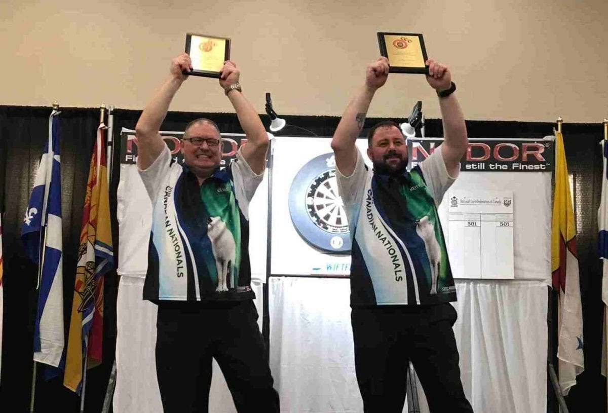 Elvis Beaudoin, left, and Keith Way hoist the champions plaques after winning the mens doubles title at the Adult National Darts Championships in Saskatoon in 2019. It was the first national title ever in darts for the NWT. photo courtesy of Sheh Murillo