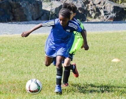 Ayanna Darku dribbles the ball upfield during a mini-game as part of the Whitecaps FC Academy camp at William McDonald Field on Sunday. James McCarthy/NNSL photo