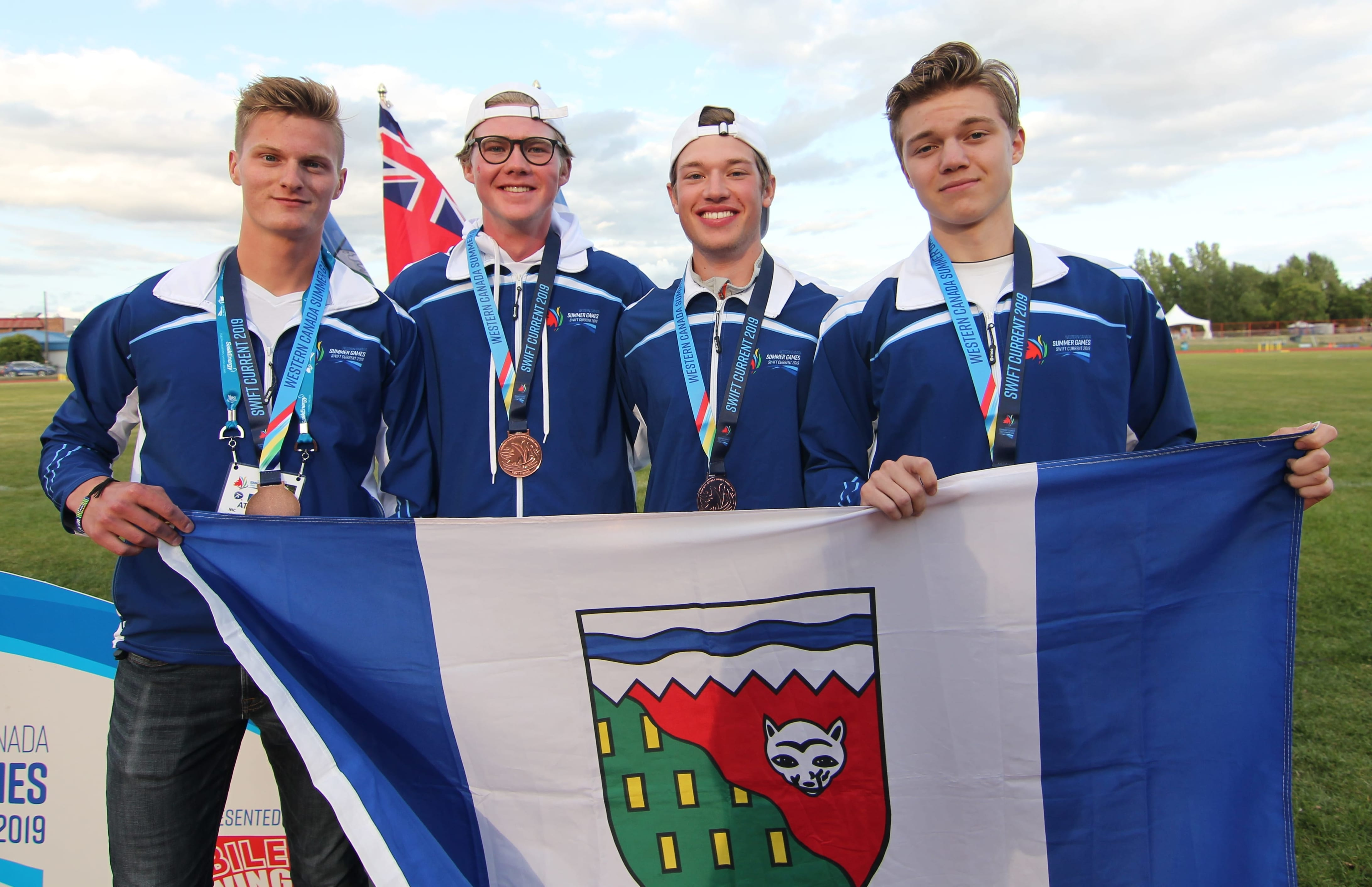 Nicolas Bennett of Yellowknife, left, Zachary Horton of Hay River, Bryce Smith of Hay River and Stryden Hult-Griffin of Inuvik captured a bronze medal for Team NT in the boys medley relay in track and field at the Western Canada Summer Games in Swift Current, Alta., on Saturday. photo courtesy of Rob Hart