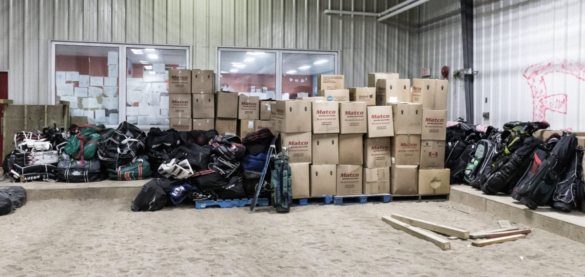 Close to $200,000 worth of sports gear showed up in Fort Providence on Nov. 15 thanks to the work of Edward Landry, a minor hockey coach in the community, Cpl. Cagri Yilmaz, detachment commander of the Fort Providence RCMP, and Sport Central, an Edmonton-based organization which provides donations to communities in need. photo courtesy of Thorsten Gohl