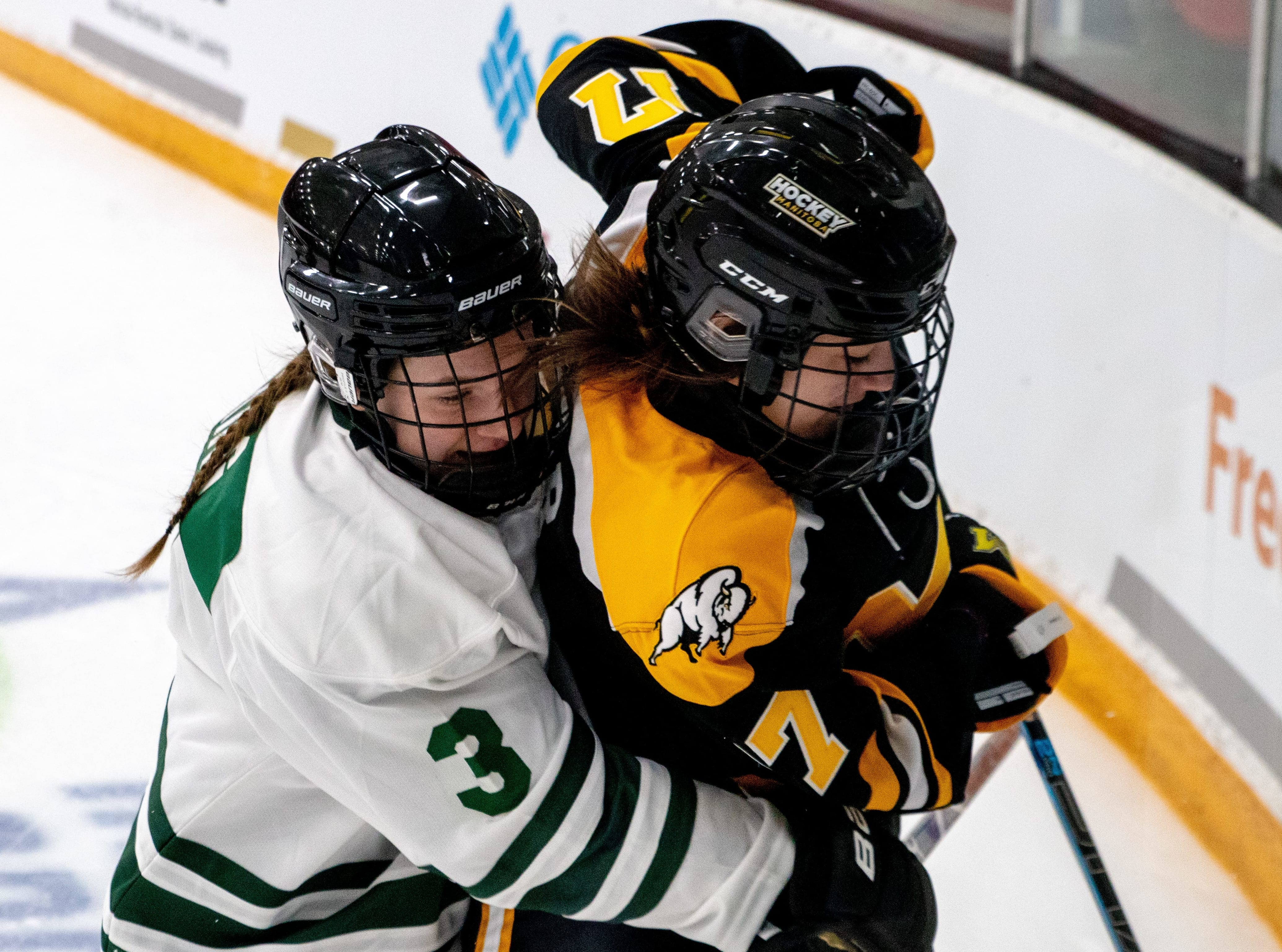 Annie King, formerly of Yellowknife and now playing in Saskatchewan, puts a Manitoba player in a bear hug during girls hockey action at the Canada Winter Games earlier this year. King will get the chance to wear the maple leaf as a member of Team Canada at the U-18 Women's World Hockey Championship in Slovakia next month after being named to the roster on Monday. Janine Johnsey/Canada Winter Games photo