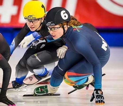 Wren Acorn, right, battles for position during action at the Canadian Junior Short Track Championships in Calgary on Nov. 29. Acorn would finish seventh overall in the meet. photo courtesy of Kerry Egan