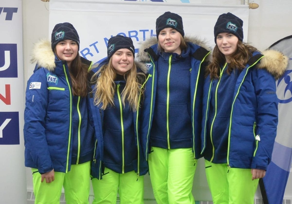 Team NT's Arctic Winter Games figure skating team of Brooke Vallis, left, Sarah Campbell, Emily Hazenberg and Victoria Hamm model off the official walk-out uniform that the team will wear during the opening ceremony in Whitehorse when the Games begin on March 15. The uniform was officially unveiled at the Sport North office in Yellowknife on Feb. 13. James McCarthy/NNSL photo