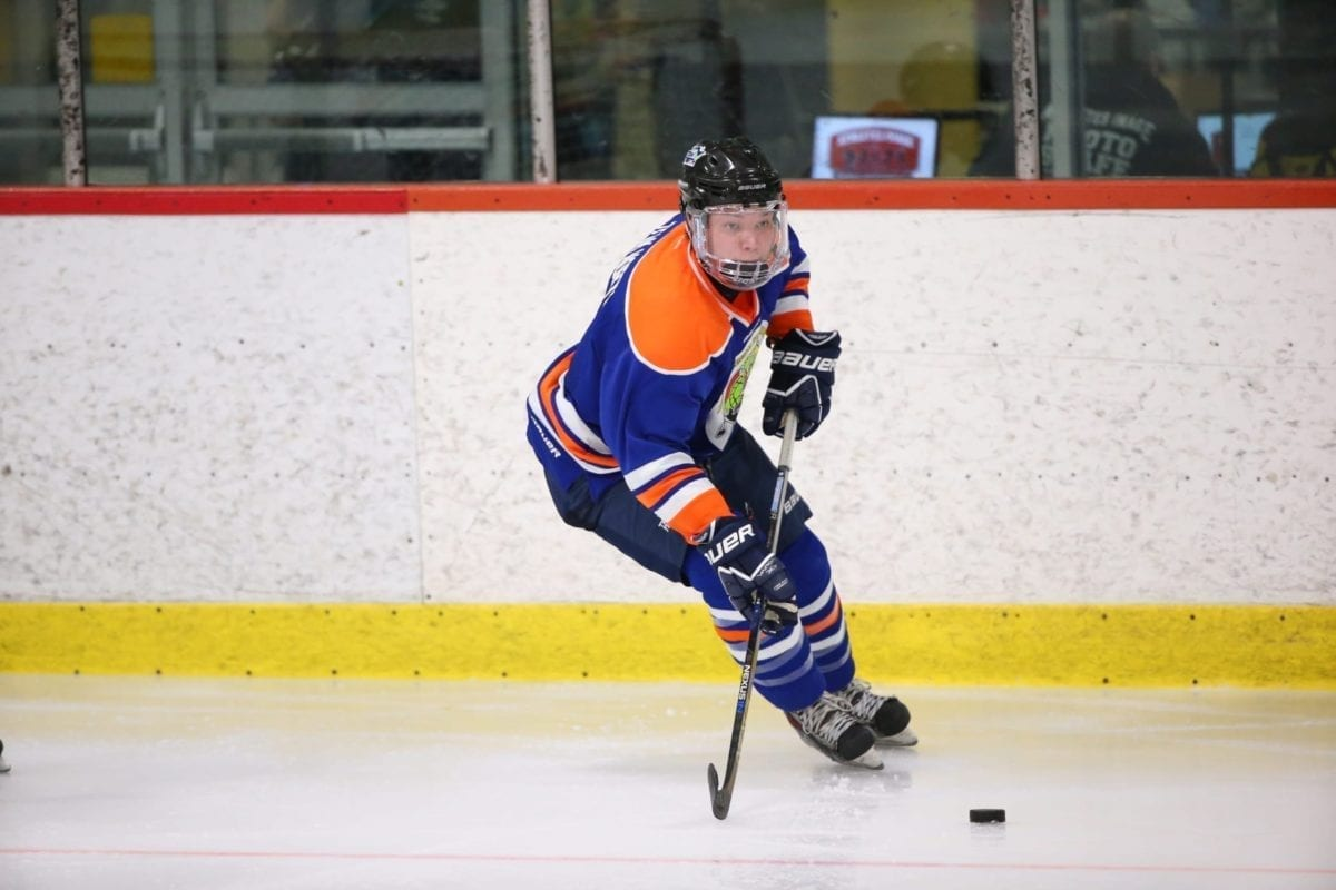 Drake Giroux carries the puck during action at the 2016 National Aboriginal Hockey Championships in Mississauga, Ont. Giroux was part of the Team North boys squad that won the first – and only to date – medal for the North at the annual tournament when they captured silver. photo courtesy of Aboriginal Sports Circle of the NWT