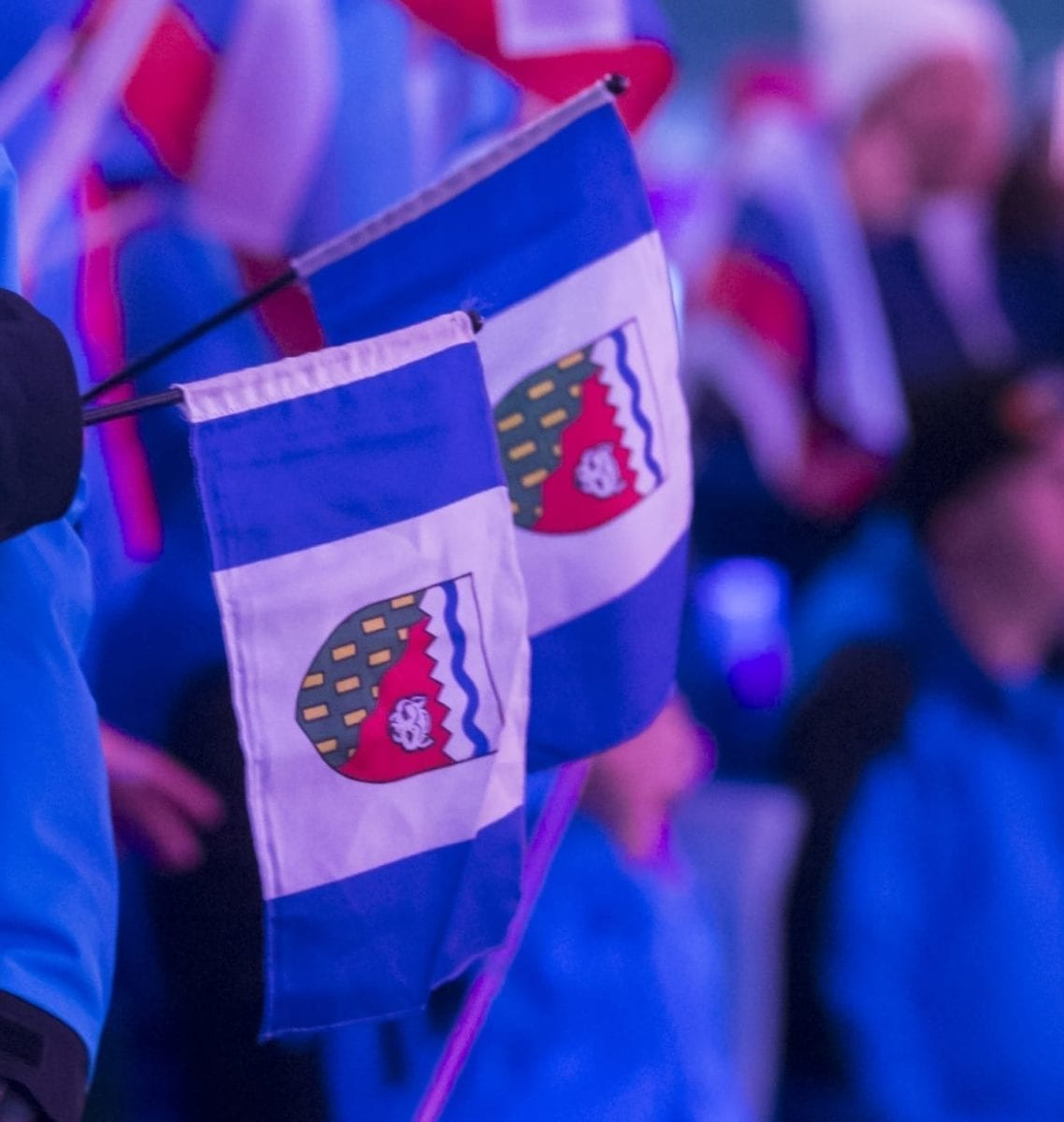 A couple of NWT flags hang out at the opening ceremony of the 2018 Arctic Winter Games in Hay River. One thing the 2018 Arctic Winter Games didn't have to worry about was the threat of Coronavirus (COVID-19), something the host society for the 2020 Arctic Winter Games has to contend with. photo courtesy of Thorsten Gohl