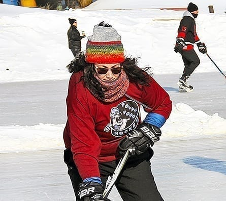 Stephanie McCabe stickhandles the puck during the 2020 Polar Pond Hockey tournament on the ice of the Hay River in front of Fisherman's Wharf. This year's edition won't happen after it was cancelled by organizers owing to the current public health restrictions. NNSL file photo