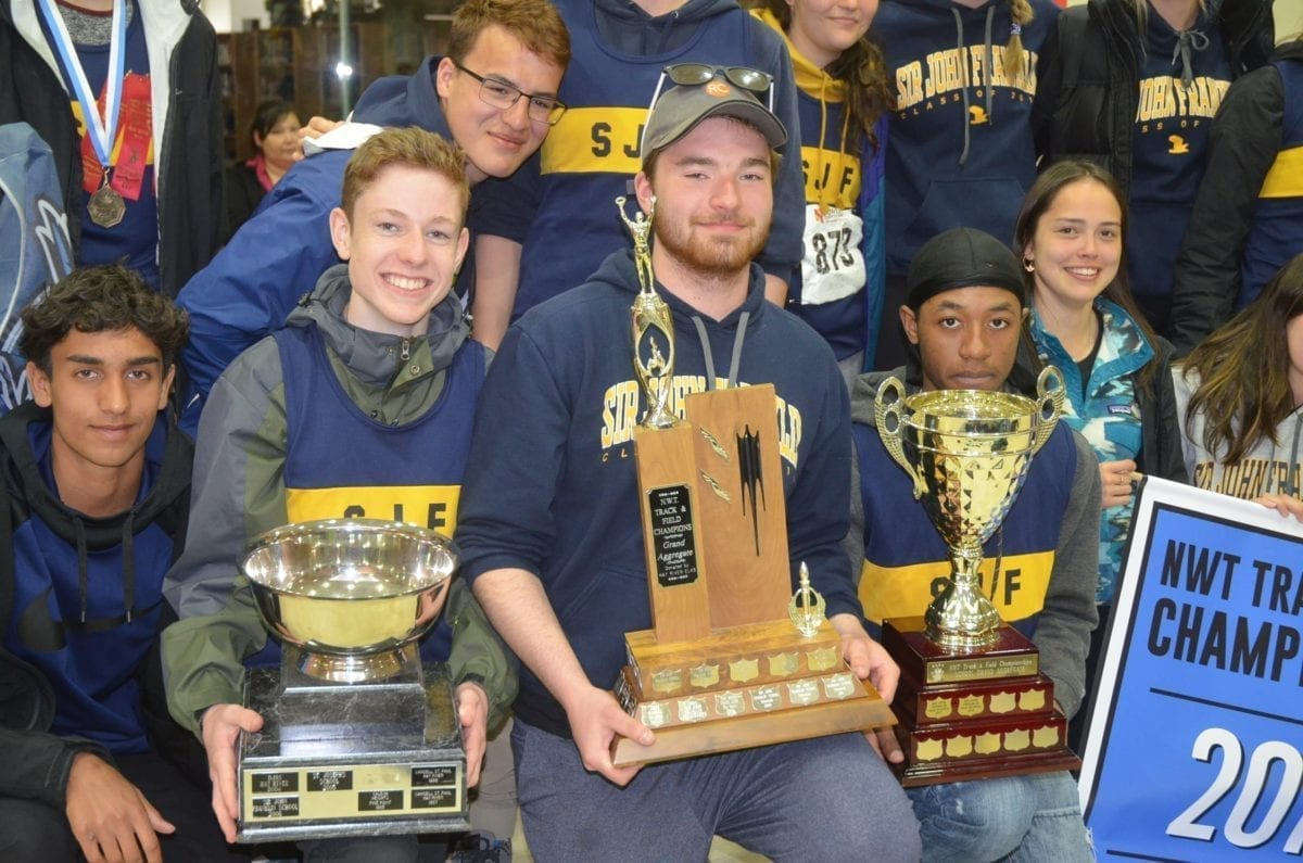 Sir John Franklin won the overall and school grand aggregate titles at the NWT Track and Field Championships in Hay River in 2019 as well as the most sportsmanlike team. Holding the most sportsmanlike trophy, left, is Robert Paddock; holding the overall grand aggregate trophy is Stephen Messier and holding the school grand aggregate trophy is Jaleel Tulloch. They will get to keep the trophies for at least one more year following the cancellation of the 2020 NWT Track and Field Championships on Tuesday. NNSL file photo