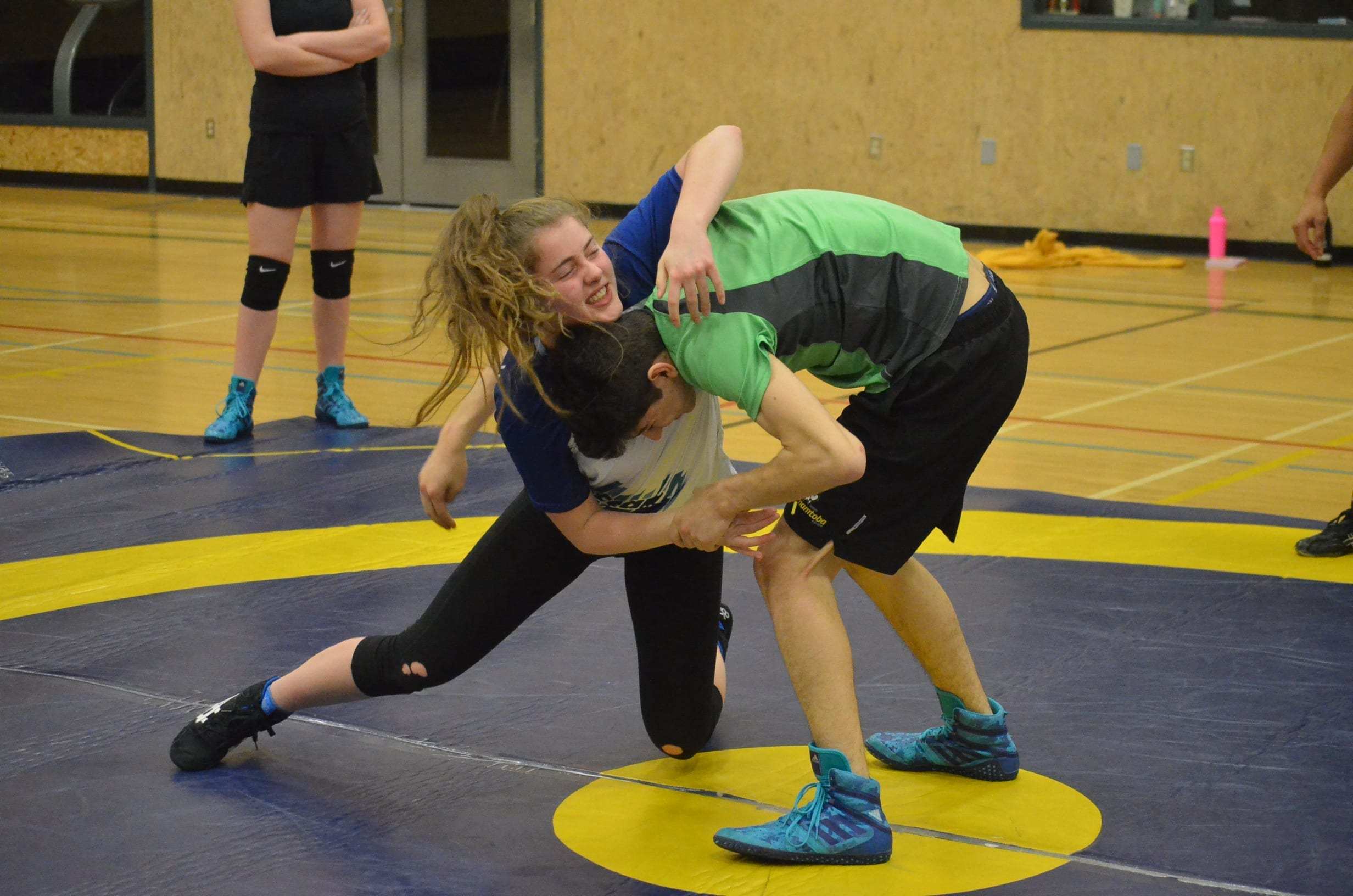 Ava Applejohn tries to get the upper hand on Quinn Critch during the wrestling trials at St. Pat's Gymnasium back in January. Both of them are now going to have to find other ways to enjoy March break following the cancellation of the Games by the host society in Whitehorse on Saturday. NNSL file photo