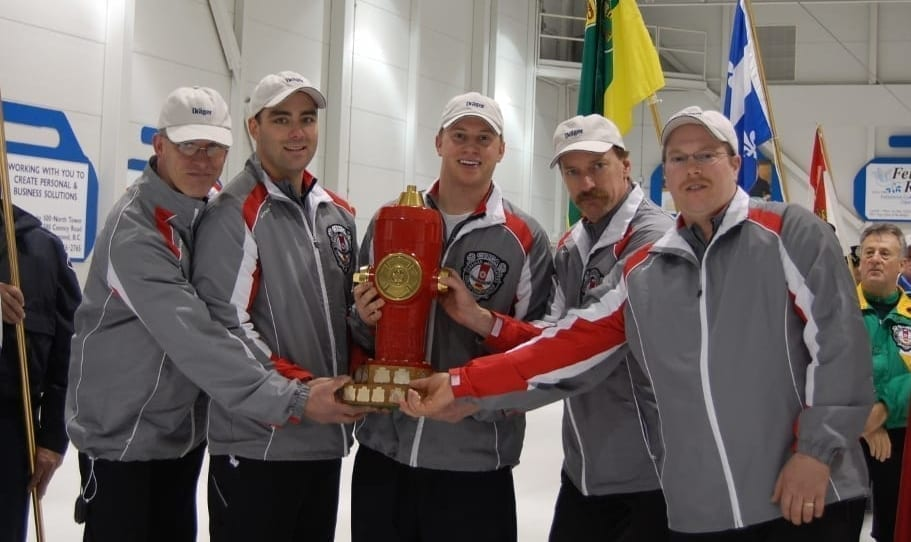 Team NWT hoisted the Hydrant, the championship trophy given to the winners of the Canadian Firefighters Curling Championship, in 2008 after running the table and going undefeated on their way to victory. They are, from left, lead Ingo Bauer, second Kevin Whitehead, third Chris Haichert, skip Steve Moss and team director Wyatt Scheller. photo courtesy of Canadian Firefighters Curling Association