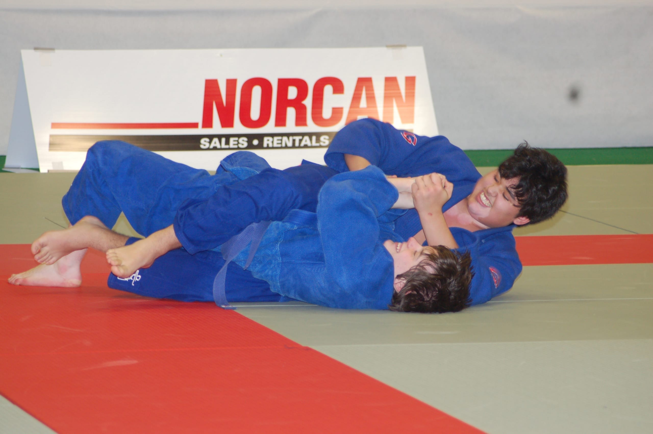 Iqaluit's Eugene Dederick, top, practices nee-waza (ground grappling) with Zachary Green at the 2007 Canada Winter Games in Whitehorse. Dederick won bronze in his weight category, the first medal for Nunavut ever at the Canada Winter Games or Canada Summer Games. NNSL file photo