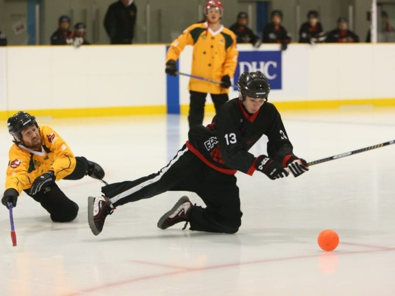 Dominic Debogorski, right, of the Ravens is all in as he attempts to put one past a Calgary Cowboys defender in the men's gold medal game at the 2014 World Broomball Championships in Japan. The Ravens would go on to win the game and the title. photo courtesy of Curtis Debogorski
