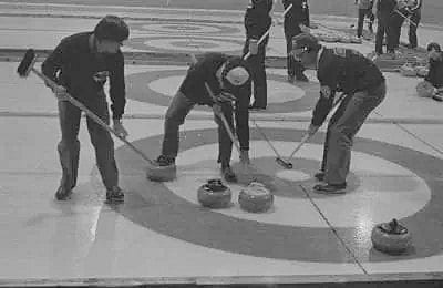 Randy Waddell, left, Don Sian and Doug Bothamley watch their rock head into the rings during the 1983 Elks Corby Cup bonspiel at the Yk Community Arena. The trio, along with skip Klaus Schoenne, would go on to win the championship and claim Yellowknife's very first national curling title.