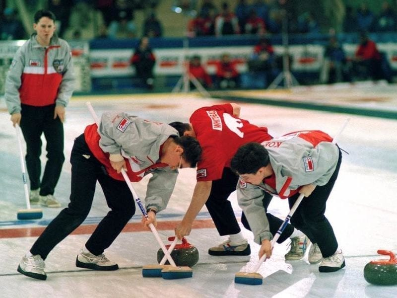 Kevin Koe, left, calls the line as Kevin Whitehead, Mark Whitehead and Jamie Koe lay the brushes during action at the 1994 Pepsi Canadian Junior Curling Championships in Truro, N.S. The rink lost in the final of that year's championships in the most heartbreaking of fashions. photo courtesy of Sport North