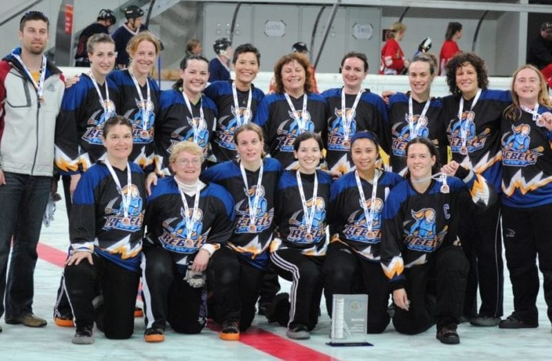 The NWT Rebels ladies broomball team show off their bronze medals won at the 2010 World Broomball Championships in Innsbruck, Austria. Front row, from left, Michelle Ramm, Val Pond, Jenny Crawford, Terri-Lynn Locke-Setter, Grace Lau-a and Tina Locke-Setter; back row, head coach Chris Greencorn, Gayle Esch, Kristal Timmer, Sherry Connors, Betty Anne Nickerson, Gwen Woodward, Lorraine Sawdon, Jen Potten, Brenda Tittlemier and Jan Vallillee. photo courtesy of International Federation of Broomball Associations