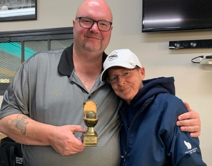 Shaun Morris, leader of the Mediocre Golf Association's Yellowknife chapter, presents the late Robin Mercer-Sproule with the top women's money winner trophy following the The Last Gasp, the final tournament of the chapter's 2019 season at the Yellowknife Golf Club. The chapter will have a full slate of tournaments this year and it will all be conducted under proper distancing guidelines. photo courtesy of Shaun Morris