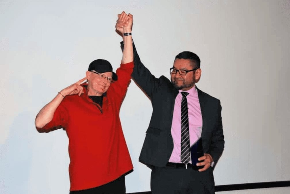 Robin Mercer-Sproule, left, has her hand raised triumphantly by Alfred Moses, Minister of Municipal and Community Affairs, after she was inducted into the athletes category of the NWT Sport Hall of Fame at the Explorer Hotel on Nov. 23. James McCarthy/NNSL photo