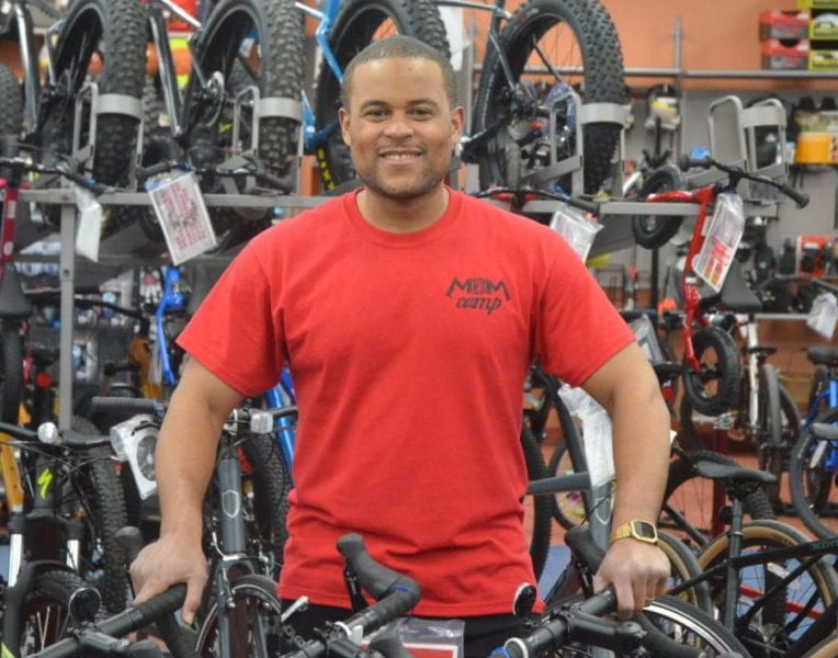 Jordan Crosby, Overlander Sports' store manager, stands among the bicycles on Tuesday afternoon. The store re-opened for business on April 27 after being closed for more than a month due to the Covid-19 pandemic. James McCarthy/NNSL photo