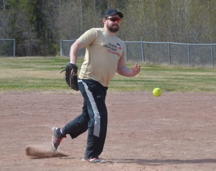 Garrett Hinchey warms up his pitching arm during a team practice at Parker Park on Sunday. Hinchey is also president of the Yk Fastball League and their season gets underway on June 15. James McCarthy/NNSL photo