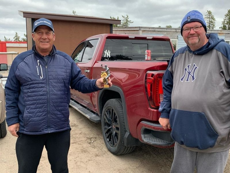 Daryl Snow, left, accepts the Mediocre Golf Association's top money-winner trophy from chapter president Shaun Morris following the final tournament of the season, The Last Gasp, at the Yellowknife Golf Club on Sunday. photo courtesy of Shaun Morris
