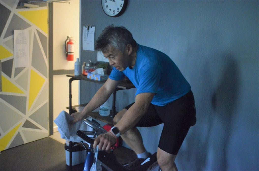 Ken Eng bears down on his bike during the Racquet Club's annual Spin-a-Thon, in support of the Stanton Territorial Hospital Foundation, on Saturday. James McCarthy/NNSL photo