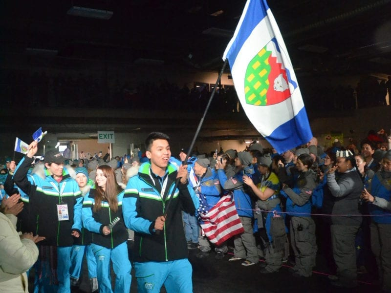 TJ Kaskamin of Fort Good Hope had the honour of carrying the NWT flag into the opening ceremony of the 2018 Arctic Winter Games in Hay River. The next flag-bearers for the territory will include one for Russia as the AWG International Committee announced on Friday that Yamal will be included as a host jurisdiction for the 2026 Games. NNSL file photo
