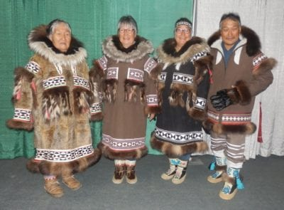 One of Kitikmeot's most skilled seamstresses is this family from Kugluktuk and Uluhaktok. Here is far left: Kate Kanayok Inuktalik, her daughter Susie Evyagotailak, Granddaughter Doreen Evyagotailak, and Son-In-Law Joe Allen Evyagotailak at a fashion show in Inuvik. The style of parkas are also Alaskan Inupiat style of coats and footwear. Navalik Tologanak/NNSL photo