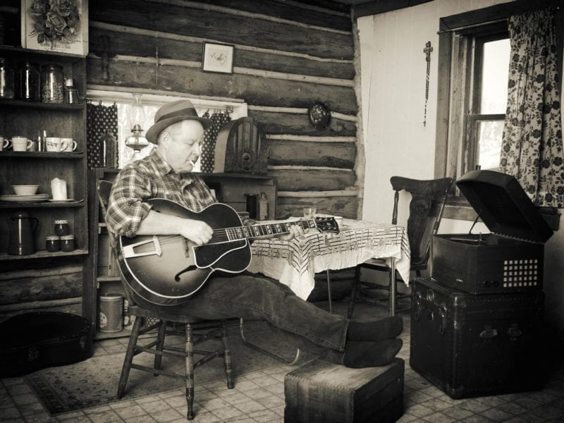 Norm Glowach will be performing on Thursday at the Northern Arts and Cultural Centre in his first indoor show as Johnny Cole since May of 2019. The cabin in the image was the home of Glowach's uncle in the 1950s. Bob Wilson photo