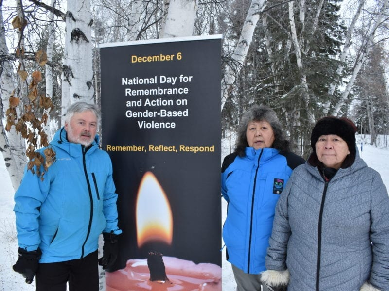 Frame Lake MLA Kevin O'Reilly, left, Sabet Biscaye and Judy Tutcho at the start of the vignette-style vigil on Sunday on the Frame Lake Trail for the 14 women murdered at L'École Polytechnique de Montreal in 1989, on the occasion of the National Day of Remembrance and Action on Violence Against Women. Blair McBride/NNSL photo