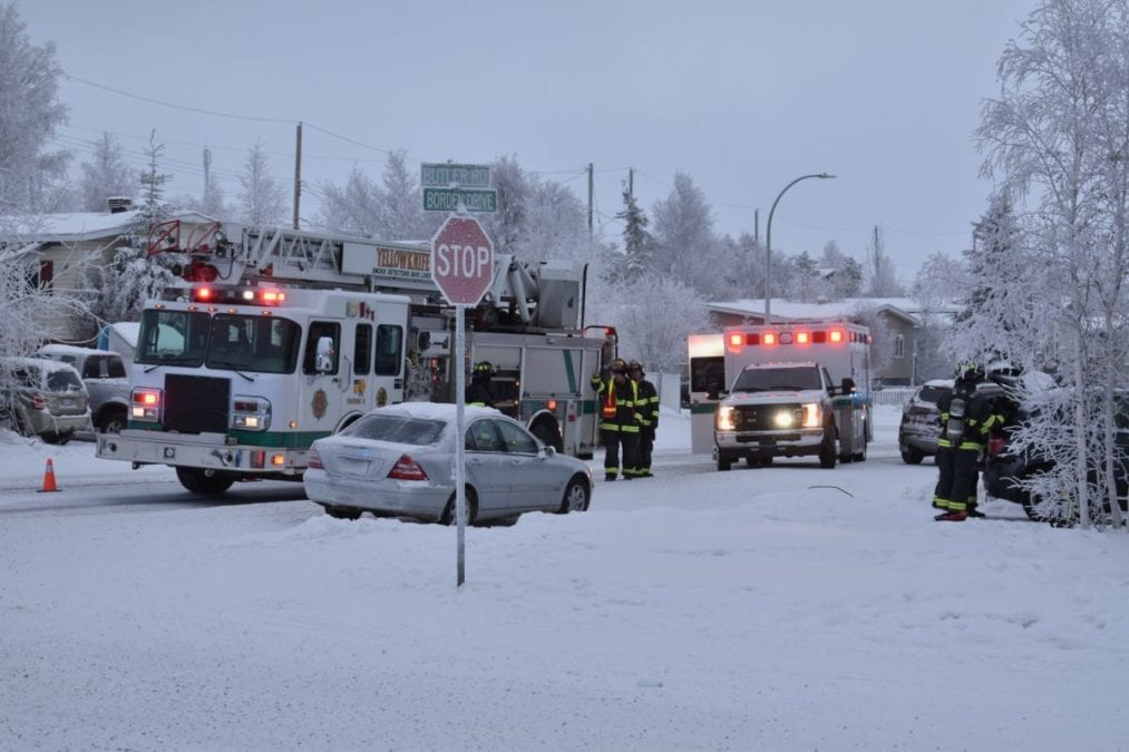 Members of the Yellowknife Fire Department and municipal enforcement officers attended to a vehicle that caught fire on Borden Drive on Tuesday afternoon. Blair McBride/NNSL photo