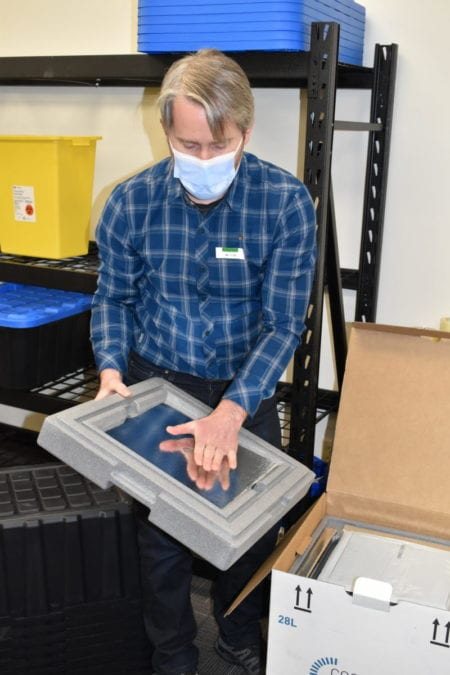 The vaccines are carried in 13-kg freezer boxes that have heavy insulated panels to maintain low temperatures, said Sean Marshall. Blair McBride/NNSL photo