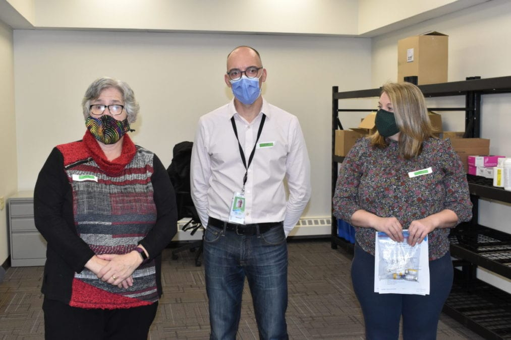 Health Minister Julie Green, left; Scott Robertson, executive co-lead for Covid-19 response; and Dawn DeBlieck, clinical nurse educator with the Northwest Territories Health and Social Services Authority spoke at a logistics demonstration in Yellowknife on Friday. Blair McBride/NNSL photo