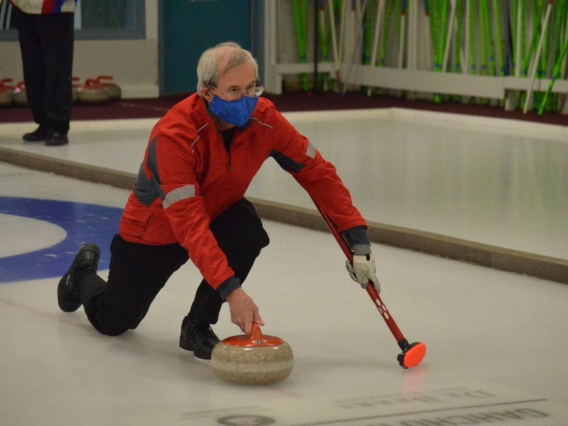 Ben McDonald is all concentration as he works on his delivery as part of the seniors instructional session at the Yellowknife Curling Centre on Jan. 16.