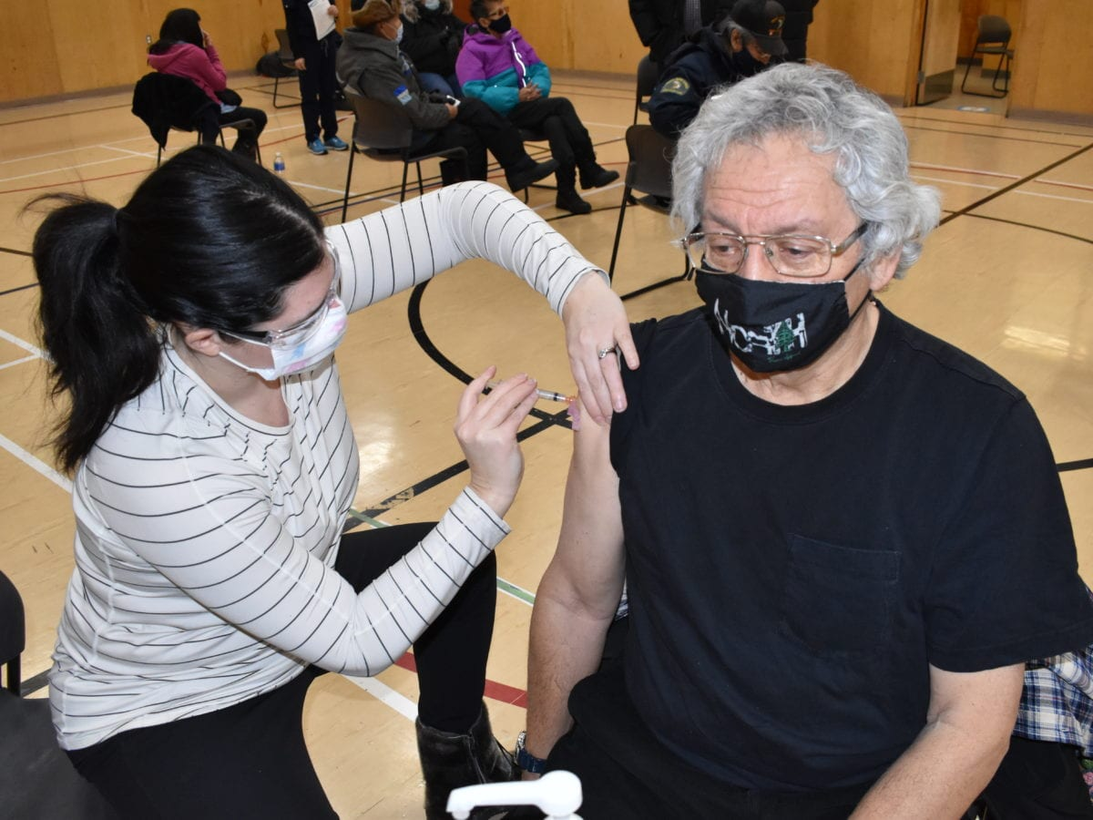 Chelsea Donaldson, left, gives a dose to George Erasmus, former chief of the Assembly of First Nations and Dene Nation. Blair McBride/NNSL photo