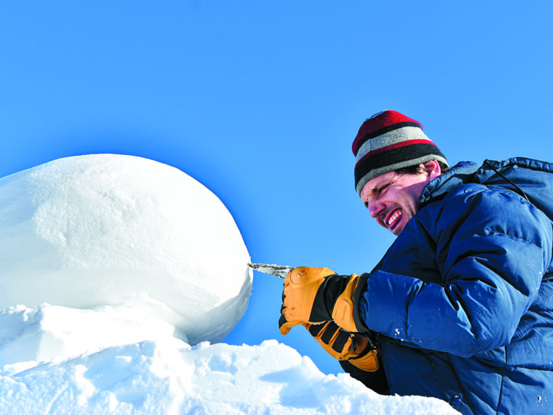 Eric Heitmann bites his tongue and squints as he perfects his international snow carving competition on Yellowknife Bay on Feb. 20. NNSL photo