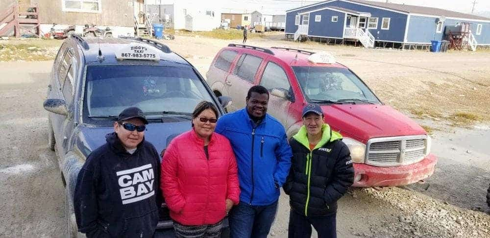 From left, Ziggy's Taxi driver Jeffrey Komak, cab company co-owners Elaine Zikalala and Charles Zikalala and driver Leonard Epilon stand with two of the company's cabs in Cambridge Bay. Zikalala is planning to offer taxi service in Kugluktuk and Rankin Inlet by October. photo courtesy of Charles Zikalala