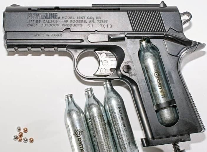 A BB gun with compressed air cartridges and pellets. Hustvedt/Wikimedia Commons photo