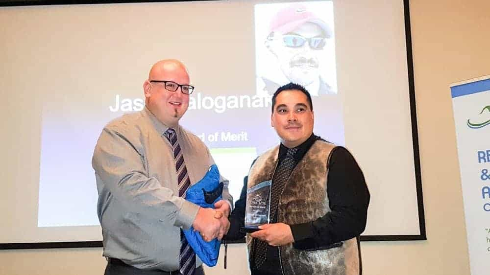 Recreation Leader of the Year award-winner Fred Muise of Cambridge Bay presents the Canadian Parks and Recreation Association Award of Merit to Jason Tologanak, also of Cambridge Bay. (recognizes an individual/organization/corporation for an outstanding contribution to achievements in each province and territory) 2016 Sport and Recreation Awards Celebration and Dinner Oct. 15, 2016 Michele LeTourneau/NNSL photo