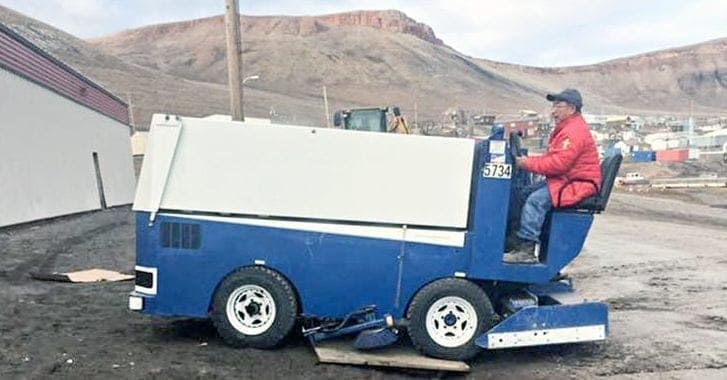 Thomas Levi, the recreation co-ordinator in Arctic Bay, drives the new Zamboni the community received on a sealift earlier this month. It's the first working Zamboni the community has had in the 23-year history of the Tununirusiq Arena. Photo courtesy of Thomas Levi.