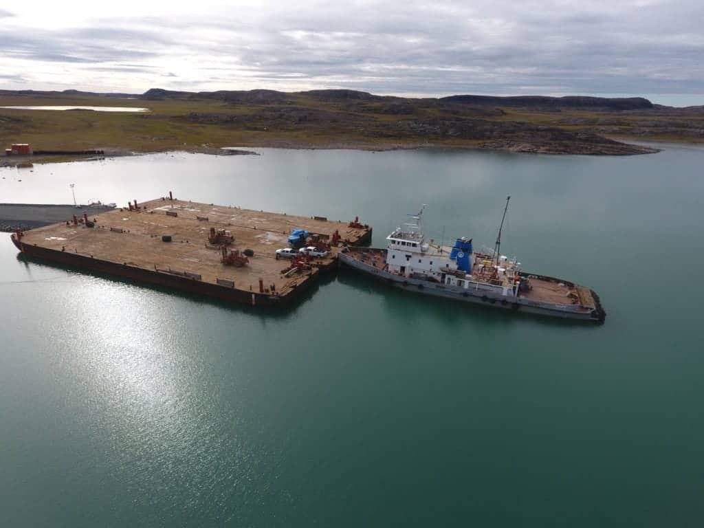 A Marine Transportation Services vessel and barge making a delivery in 2017, when Arctic Ocean conditions were much better than they are in the Kitikmeot now. Photo courtesy of the GNWT