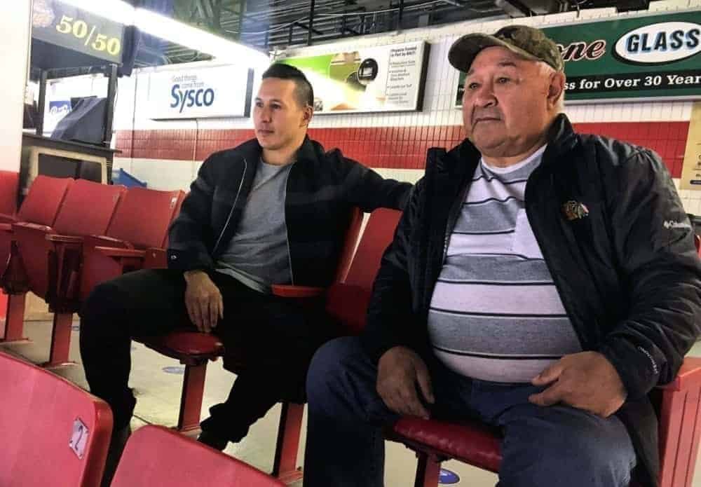 Former NHLer Jordin Tootoo of Rankin Inlet and his dad, Barney Tootoo, take in the atmosphere of the morning skate for the Brandon Wheat Kings at the Keystone Centre in Brandon, Man., on Oct. 19, 2018. Photo courtesy Wheat Kingsd family