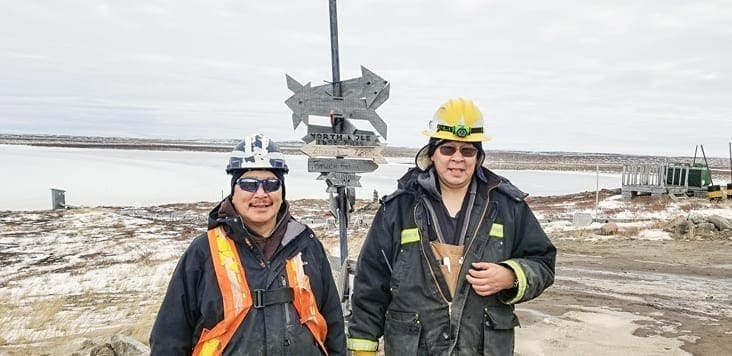 Taloyoak's Kokiak Peetooloot, left, and Jimmy Porter of Gjoa Haven are Sabina Gold and Silver employees working at the Goose camp, approximately 75 km southwest of Bathurst Inlet. Sabina provides training on various pieces of equipment and puts a great deal of emphasis on safety, Porter says. Photo courtesy of Sabina Gold & Silver.