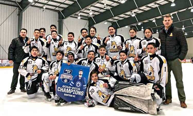 The 2018 Winnipeg Jets Challenge Cup A1 Division champion Rankin Rock bantam team are, back row from left, Simon Wiseman, Kobe Tanuyak, Chase Herron, Malla Ittinuar, Brady Tucktoo, Charlotte Siksik, Alanna Airut and David Clark (head coach), and middle from left, Bubsy Kusugak (Assistant coach), Max Ammaq, Gregory Wiseman, Mapsala Komok and Sandy Tattuinee, and third row from left, Adam Taipana, Kadin Eetuk, Kayden Mercer, Koby Connelly, Owen Connelly-Clark, Terence Pilakapsi and Justin Towtongie and goalie Tucket St. John, front, in Winnipeg, Man., on Dec. 30, 2018. Photo courtesy Rankin Rock