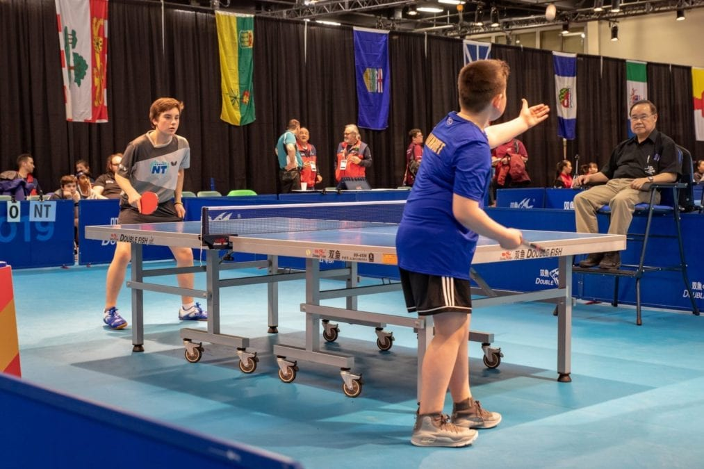 Conner McKay-Ivanko of Hay River, left, awaits the serve from Caleb Bolt of Kugluktuk during table tennis action at the 2019 Canada Winter Games in Red Deer, Alta., on Feb. 16. Peter Fuzessery/Canada Winter Games photo