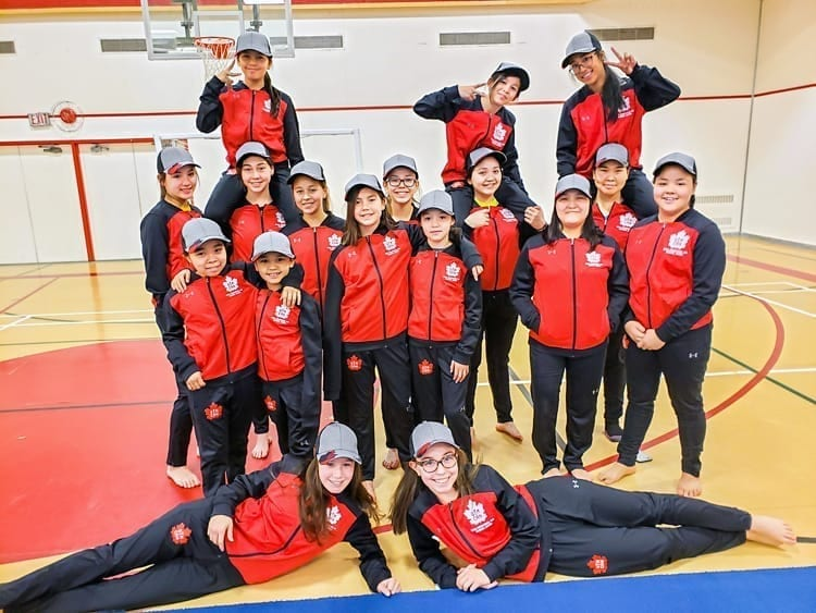 Members of the Rankin Inlet competitive gym team, back from left, Abby Mac Donald, Kylie Mae Aksalnik and AJ Libatique, and third row from left, Maya Hidalgo, Alyson McKay, Audrey Fredlund, Raegan Tattuinee, Nefretiri Innukshuk and Caroline Gibbons, and second row from left, Latasha Nirlungayuk, Yzabell MacDonald, Kortni McKay, Kyrene Angootealuk, Rachel Tutanuak and Josie Panika, and front from left, Lexus Dion and Bailey Green, are over the moon with happiness as they receive their Team Canada uniforms for the upcoming World Gymnaestrada in Austria in Rankin Inlet on Jan. 30, 2019. Photo courtesy Lisa Kresky