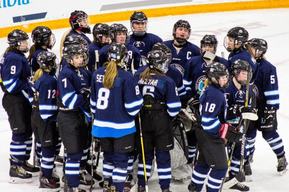 Team NT's girls hockey team gathers around following their game against Prince Edward Island at the Canada Winter Games in Red Deer, Alta., on Feb. 24. Mel Bolin/Canada Winter Games photo