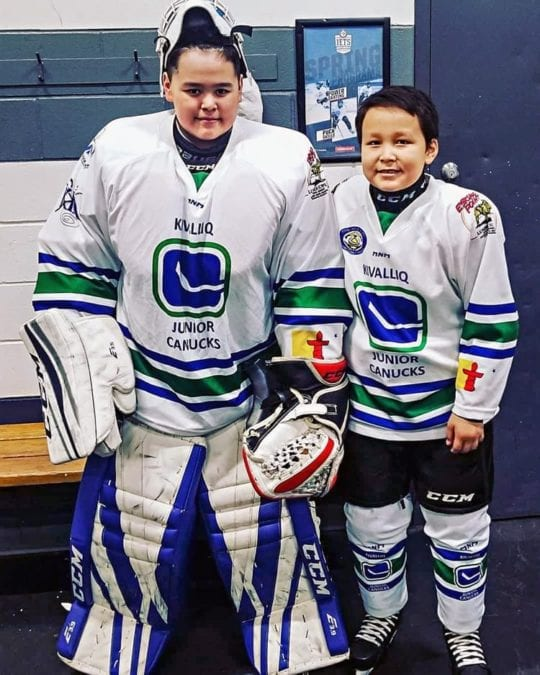 Jimmy Ollie, left, and Frances Uppahuak are ready for action before the MICEC Annual Indigenous Minor Hockey Tournament in Winnipeg last month. Photo courtesy of Gleason Uppahuak