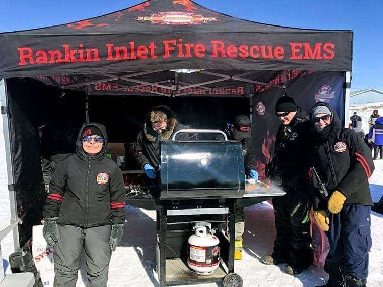 Emergency services personnel, from left, Maryann Aksadjuak, Scott Morey, George Aksadjuak, Kyle Lowe and Hannah Hutchinson keep the tasty hotdogs coming during the third annual Easter Eggstravaganza in Rankin Inlet on April 20, 2019. Photo courtesy Mark Wyatt